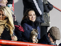 Jessica Bueno watches Brentford FC's Jota during the FA Cup Third Round match between Brentford and Brighton and Hove Albion at Griffin Park, London 03/01/2015<br /> Picture by Mark D Fuller