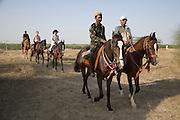 Rider arriving back at camp on Marwari horses at the Mallinath Fair at Tilwara  near Balotra, Rajasthan, India