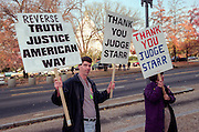 Protesters calling for impeachment of President Clinton rally outside Congress as the House Judiciary Committee begins Clinton impeachment hearings November 19, 1998 in Washington, DC.