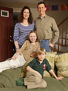 Christine Odgen, left, her husband Randee Ogden, right, and their children Rachael and Luke  pose for a portrait in their home in Circleville on March 15, 2010.