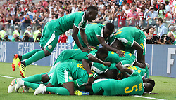 Senegal's M'Baye Niang (hidden) is mobbed by team-mates as he scores his side's second goal of the game