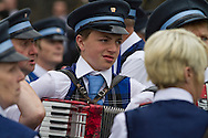 A boy member of an accordion band pictured before the start of Pipefest Stirling, an event staged at Stirling Castle to coincide with the 700th anniversary of the Battle of Bannockburn. The event was attended by 1600 pipers, Highland dancers and other musicians and formed a procession through the city's streets. The Battle of Bannockburn took place in 1314 and resulted in the defeat of Edward II's English army by the Scots under Bruce.