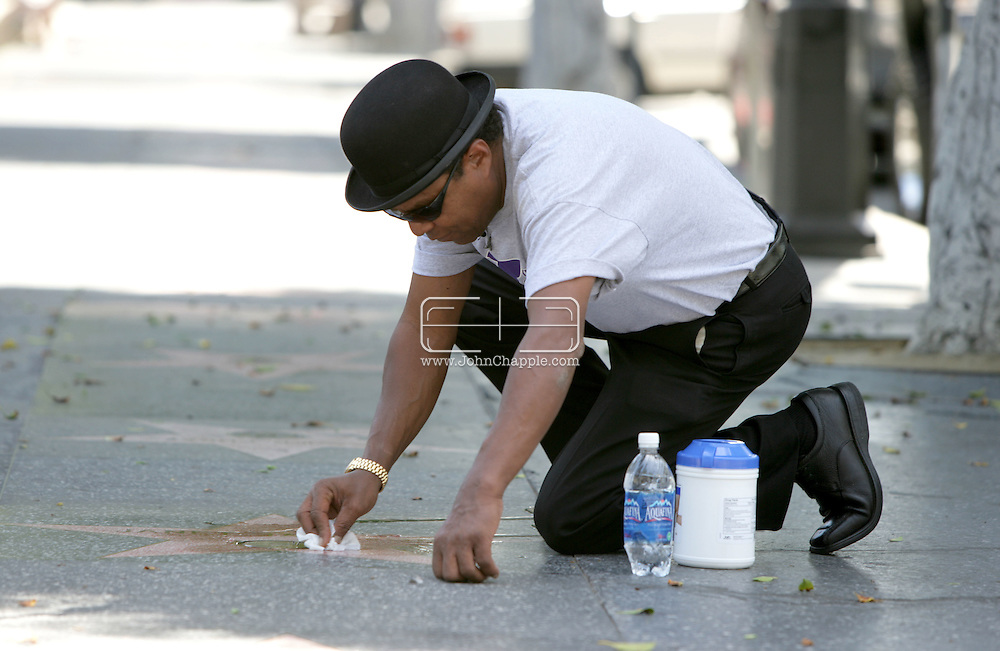 15th May 2008, Hollywood, Califorinia. Tito Jackson from the 'Jackson Five' gets down on his hands and knees to clean the his younger sister, Janet Jackson's star on the Hollywood Walk Of Fame. PHOTO © JOHN CHAPPLE / REBEL IMAGES.john@chapple.biz     www.chapple.biz