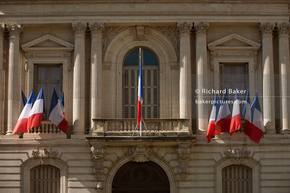 National flags hanging outside the Prefecture (an administrative jurisdiction), on Place des Martyrs de la Resistance, Montpellier, south of France.