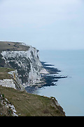 The White Cliffs of Dover, Kent. One of the most famous and iconic landmarks of Britain. They face the straights of Dover between England and France. They are part of the North Downs formation and are mostly made up of chalk.