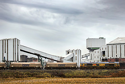 © Licensed to London News Pictures. 17/12/2015. Kellingley UK. A coal train passes through Kellingley Colliery in Yorkshire as Britain's last deep coal mine prepares to close down tomorrow (friday 18th December) with the loss of 450 jobs. Photo credit: Andrew McCaren/LNP