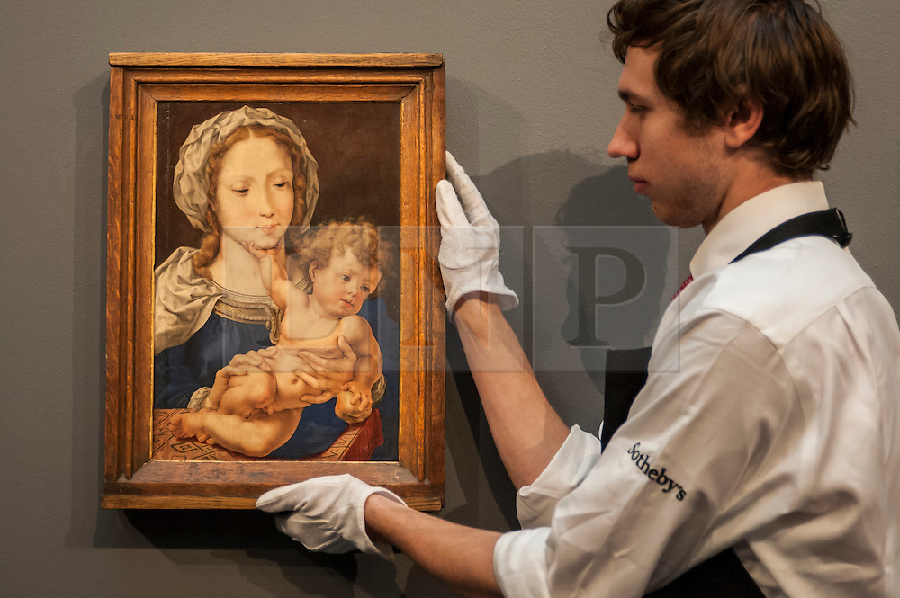 """© Licensed to London News Pictures. 04/12/2015. London, UK. A technician holds """"Mabuse"""" by Jan Gossaert (est. £4-6 million), ahead of Sotheby's London evening sale of Old Master and British paintings on 9th December 2015.  Photo credit : Stephen Chung/LNP"""