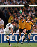Photo: Richard Lane.<br />Australia v England. Rugby World Cup Final, at the Telstra Stadium, Sydney. RWC 2003. 22/11/2003. <br />Jonny Wilknson slots the winning drop goal as Phil Waugh attempts to charge down.
