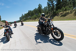 Kissa Von Addams and Sarah Furey of the Iron Lilies on the Legends Ride during the annual Sturgis Black Hills Motorcycle Rally.  SD, USA.  August 8, 2016.  Photography ©2016 Michael Lichter.