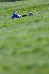 A woman relaxes in the hot sunshine on the grass of Parliament Hill in London February 10 2018.