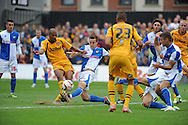 Chris Zebroski of Newport County is beaten to the ball by Tom Lockyer of Bristol Rovers (c) . Skybet League two match, Newport county v Bristol Rovers at Rodney Parade in Newport, South Wales on Saturday 17th August 2013. :  pic by Phil Rees ,Andrew Orchard sports photography,