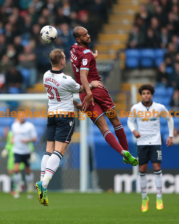 Port Vale striker Rigino Cicilia (9) and Bolton Wanderers defender David Wheater  (31) go for the ball during the Sky Bet League 1 match between Bolton Wanderers and Port Vale at the Macron Stadium in Bolton. October 29, 2016.<br /> Nigel Pitts-Drake / Telephoto Images<br /> +44 7967 642437
