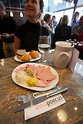 Vienna. Porcus altoesterreichische Schweinerei, a stylish fast food and take away specialized in traditional and exotic pork delikatessen. Cooked ham.