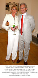 PETER & JAN SCOTT they own Ashe Park water, at a party in London on 28th May 2003.PJZ 233