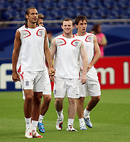 Photo: Chris Ratcliffe.<br />England Training Session. FIFA World Cup 2006. 30/06/2006.<br />Wayne Rooney, Rio Ferdinand (L) and Gary Neville in training.