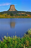 Reflections of Devils Tower in a small reservoir near the monument.  Devils Tower National Monument, Wyoming.