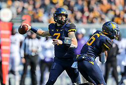 Nov 10, 2018; Morgantown, WV, USA; West Virginia Mountaineers quarterback Will Grier (7) throws a pass during the first quarter against the TCU Horned Frogs at Mountaineer Field at Milan Puskar Stadium. Mandatory Credit: Ben Queen-USA TODAY Sports