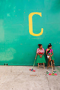 Workers of Cooperativa Café Timor take a break outside the coffee processing plant in Dili, East Timor.