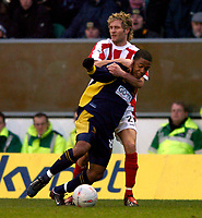 Photo: Richard Lane.<br /> Wimbledon v Stoke City. FA Cup 5th Round. 03/01/2004.<br /> Wade Small is wrestled to the ground by John Halls.