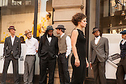 Men loiter by the Flatiron building as dancer Marie-Therese Bjornerud walks by,