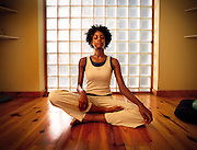 An african-american woman enjoys her morning yoga session at home