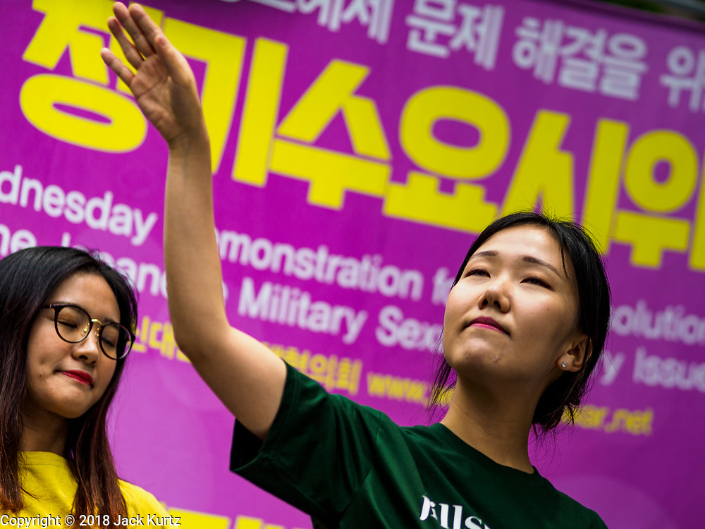 """SEOUL, SOUTH KOREA: Women do an interpretive dance during the Wednesday protest at the Japanese embassy in Seoul. The Wednesday protests have been taking place since January 1992. Protesters want the Japanese government to apologize for the forced sexual enslavement of up to 400,000 Asian women during World War II. The women, euphemistically called """"Comfort Women"""" were drawn from territories Japan conquered during the war and many came from Korea, which was a Japanese colony in the years before and during the war. The """"comfort women"""" issue is still a source of anger of many people in northeast Asian areas like South Korea, Manchuria and some parts of China.       PHOTO BY JACK KURTZ   <br /> Wednesday Demonstration demanding Japan to redress the Comfort Women problems"""