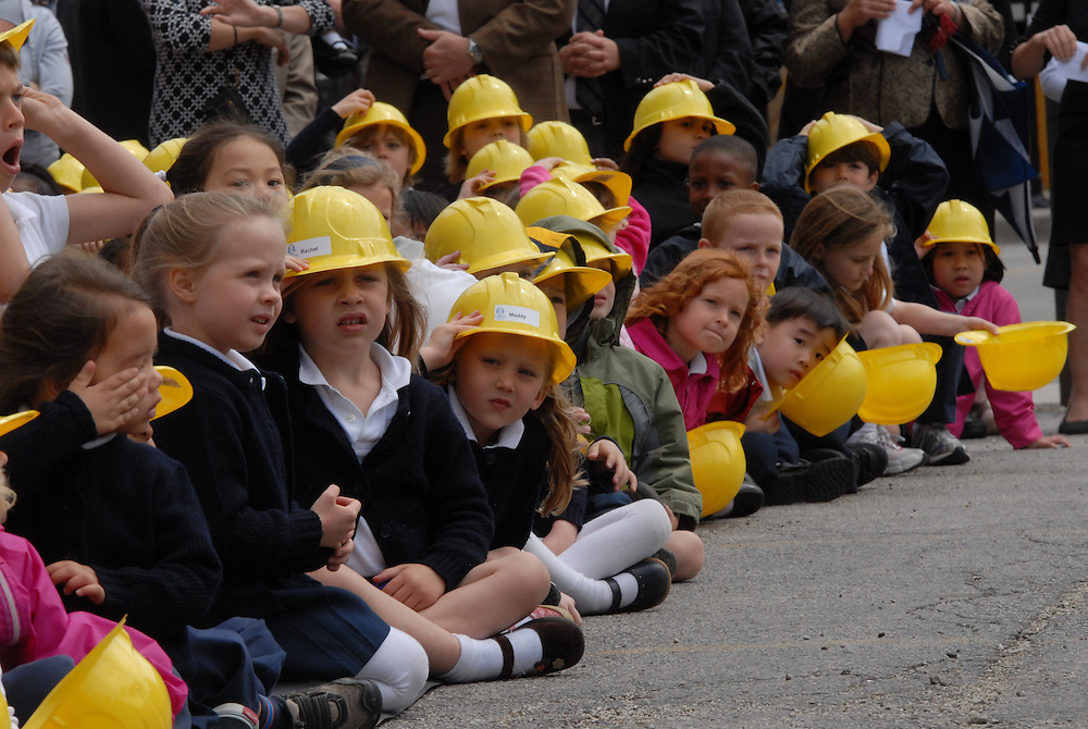Students at Old St. Mary's Catholic Church in Chicago's South Loop neighborhood attend a ground breaking ceremony for their new school attended by Archbishop Francis Cardinal George.