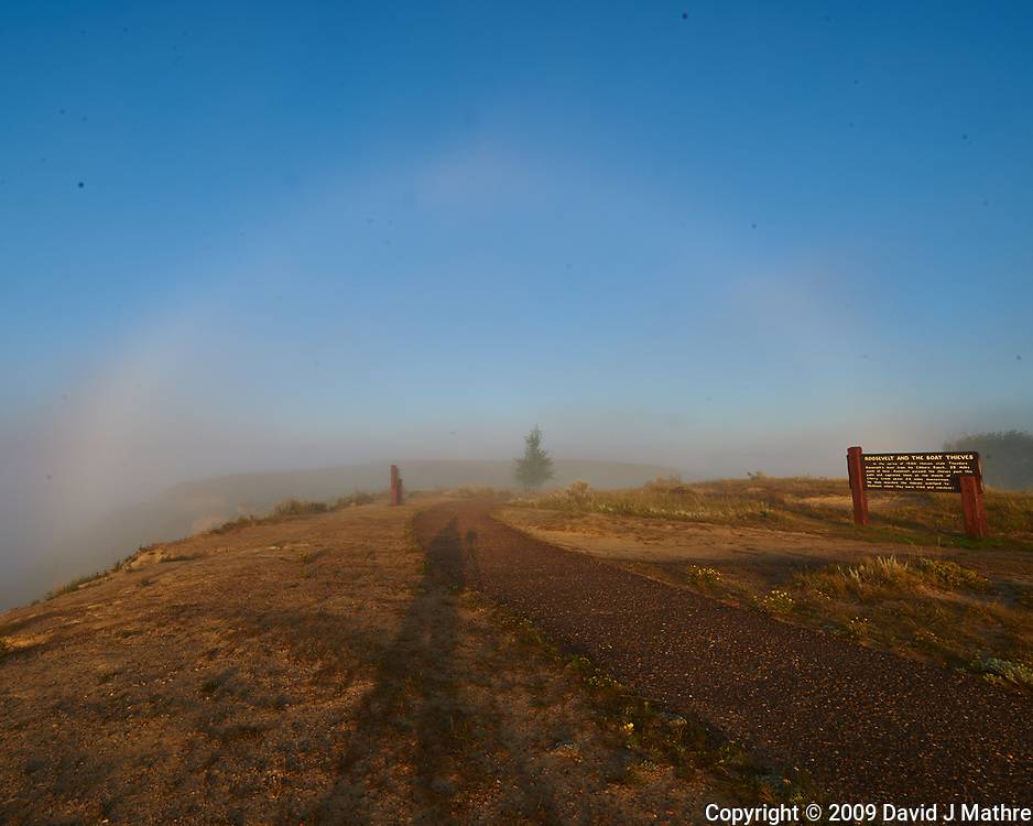 Fog Rainbow and Photographer's Shadow. Little Missouri river overlook. Image taken with a Nikon D3x camera and 14-28 mm f/2.8 lens (ISO 100, 14 mm, f/16, 1/40 sec).