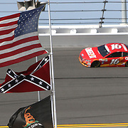 Sprint Cup Series driver Greg Biffle (16) speeds through turn 4 where a confederate flag is posted during the 57th Annual NASCAR Coke Zero 400 practice session at Daytona International Speedway on Friday, July 3, 2015 in Daytona Beach, Florida.  (AP Photo/Alex Menendez)