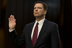 June 8, 2017 - Washington, District Of Columbia, USA - Former FBI Director JAMES COMEY is sworn in prior to testifying to the Senate Intelligence Committee about his conversations with President Trump concerning Trump's ties to Russia on Capitol Hill in Washington, D.C. on June 8th, 2017. (Credit Image: © Alex Edelman via ZUMA Wire)
