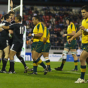 Tom Marshall is congratulated by team mates after scoring a New Zealand try during the Australia V New Zealand Final match at the IRB Junior World Championships in Argentina. New Zealand won the match 62-17 at Estadio El Coloso del Parque, Rosario, Argentina. 21st June 2010. Photo Tim Clayto..