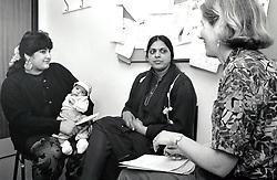 Postnatal check up with doctor, Nottingham UK 1991