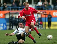 Photo:  Frances Leader.<br /> Luton Town v Swindon Town. Coca Cola league one. <br /> Kenilworth Road Stadium<br /> 12/03/2005<br /> Luton's Russell Perrett tackles Swindon's Sam Parkin