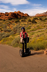 Woman on a Segway, Snow Canyon State Park, Utah, UT, scenic, landscape, Segways, Segway rider, model released, rock formations, landforms, arid, Southwest America, American Southwest, US, United States, Image ut411-18594, Photo copyright: Lee Foster, www.fostertravel.com, lee@fostertravel.com, 510-549-2202