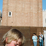 A young boy with a pigeon in Piazza San Marco. Venice, Italy. 1st May 2011. Photo Tim Clayton