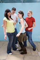 Group of teenagers dancing,