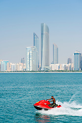 Skyline of modern skyscrapers on waterfront in Abu Dhabi United Arab Emirates UAE