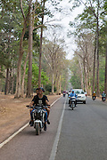 Young Cambodian's ride on a motorcycle along a road with other bikes and cars on Krong Siem Reap Province, Cambodia, South East Asia. (photo by Andrew Aitchison / In pictures via Getty Images)