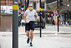 © Licensed to London News Pictures. 11/09/2020. Birmingham, , UK. Birmingham Restrictions. Pictured, A jogger exercising in Birmingham City Centre this morning. There has been a significant rise in the spread of Coronavirus in Birmingham. Although the City has been on a watch list for some weeks. Council Leaders are expected to announce new restrictions to help halt the rise of infections. Photo credit: Dave Warren / LNP