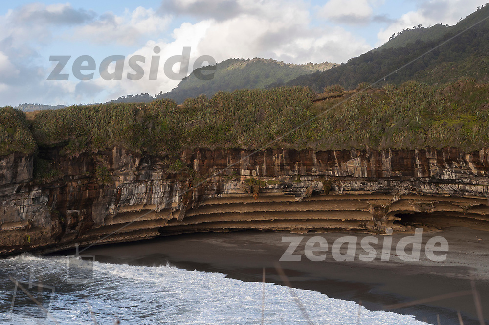 A large limestone arc in a bay north of Punakaiki.