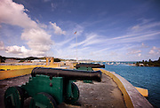 Cannons are lined up at the water's edge in an old fort in St. Croix, US Virgin Islands.