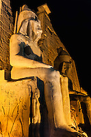 Egypt. Luxor Temple is a large temple complex founded in 1400 BC. Two large statues at the entrance.