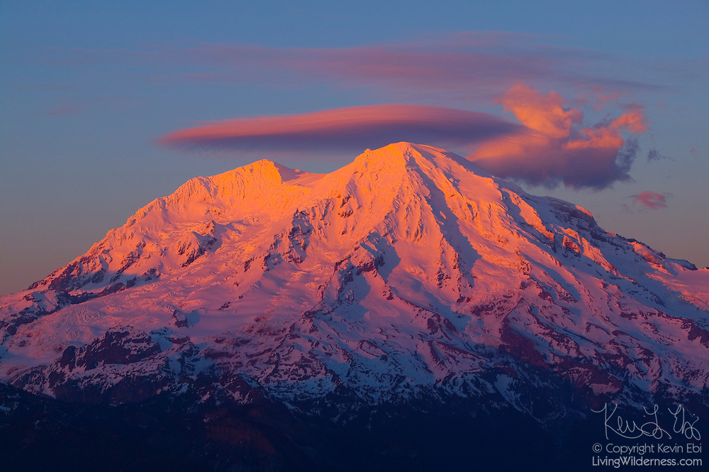 The last light of day illuminates the winter snow pack on Mount Rainier in this view from High Rock.