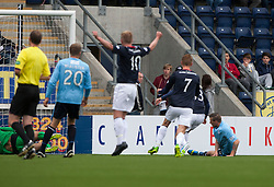 Falkirk's Rory Loy (hidden, right) scoring first goal.<br /> half time : Falkirk 1 v 0 Dundee, 21/9/2013.<br /> ©Michael Schofield.