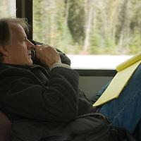 Photographer Bill Hatcher catches up on work after a seminar in Banff National Park.