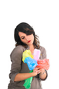 Zero Waste concept - young woman reuses used plastic bags into flowers studio shot on white background