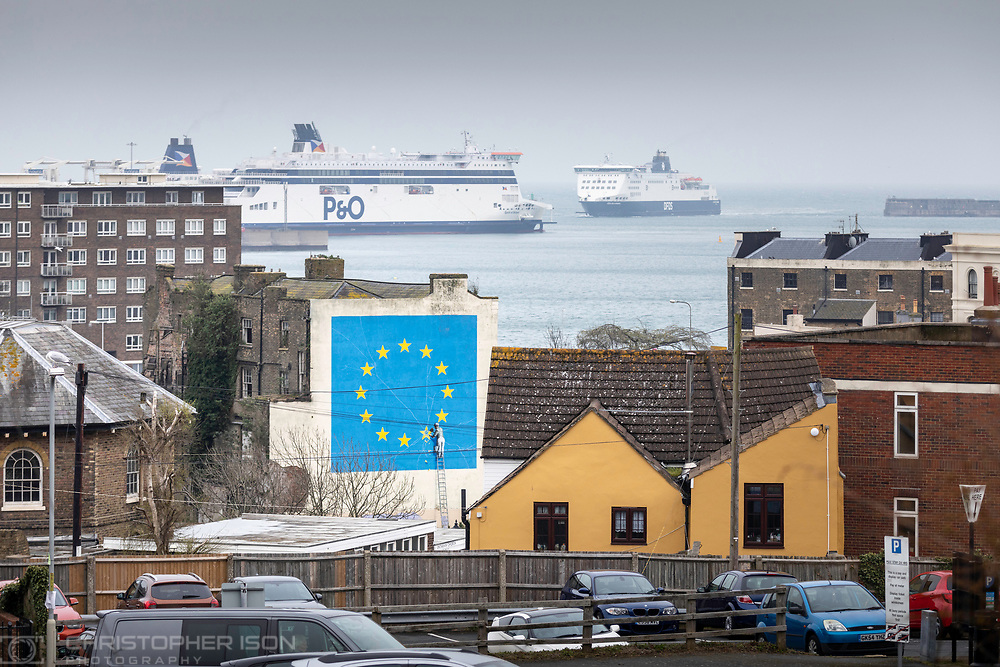 What next for Brexit??<br /> A ferry approaches the Port of Dover where Banksy's famous Brexit mural stands large on the side of a derelict building.  <br /> Picture date Wednesday 10th April, 2019.<br /> Picture by Christopher Ison. <br /> 07544044177<br /> chris@christopherison.com<br /> www.christopherison.com