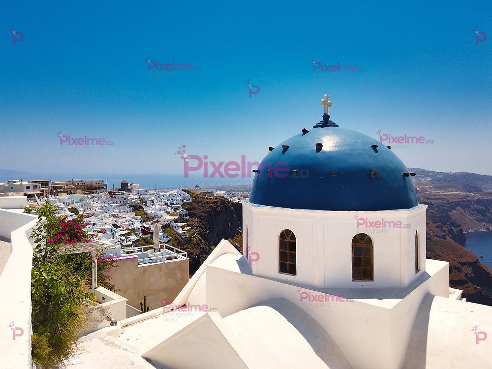 Majestic view of Nikolaus monastery with domed church and on seashore of Santorini island in Greece