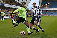 Lys Mousset of Bournemouth and Tony Craig of Millwall compete for the ball. The Emirates FA Cup 3rd round match, Millwall v AFC Bournemouth at The Den in London on Saturday 7th January 2017.<br /> pic by John Patrick Fletcher, Andrew Orchard sports photography.