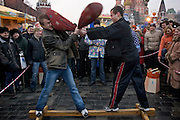 Moscow, Russia, 13/03/2005..Russians play games on Vasilevsky Spusk by Red Square as they celebrate the  final day of Maslenitsa, or Pancake Week, a Russian holiday which dates back to pagan times and marks the official end of winter.